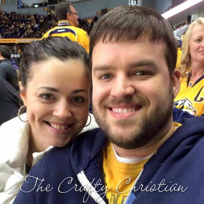 Stefani and her husband at a hockey game