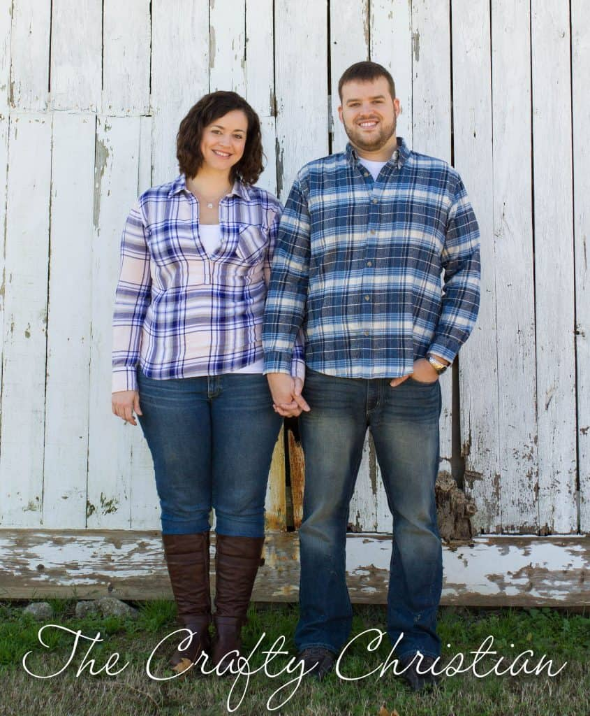 Stefani and her husband in front of a barn door