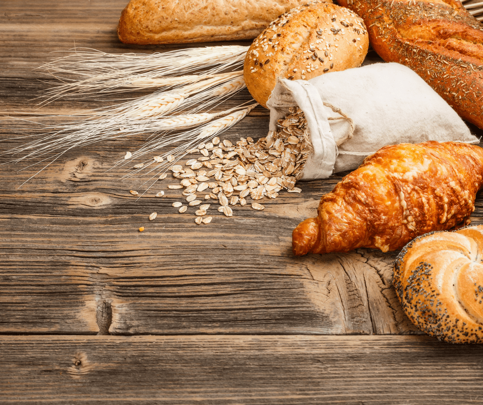 many breads and oats on a wooden table