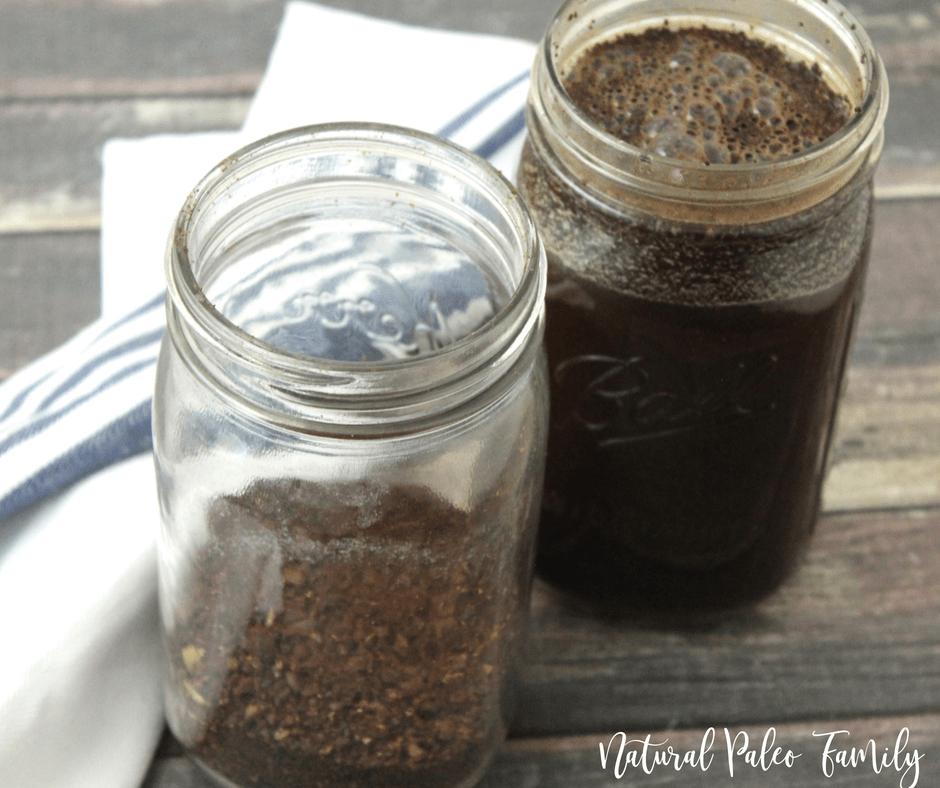 mason jar with ground coffee next to a mason jar with ground coffee and water
