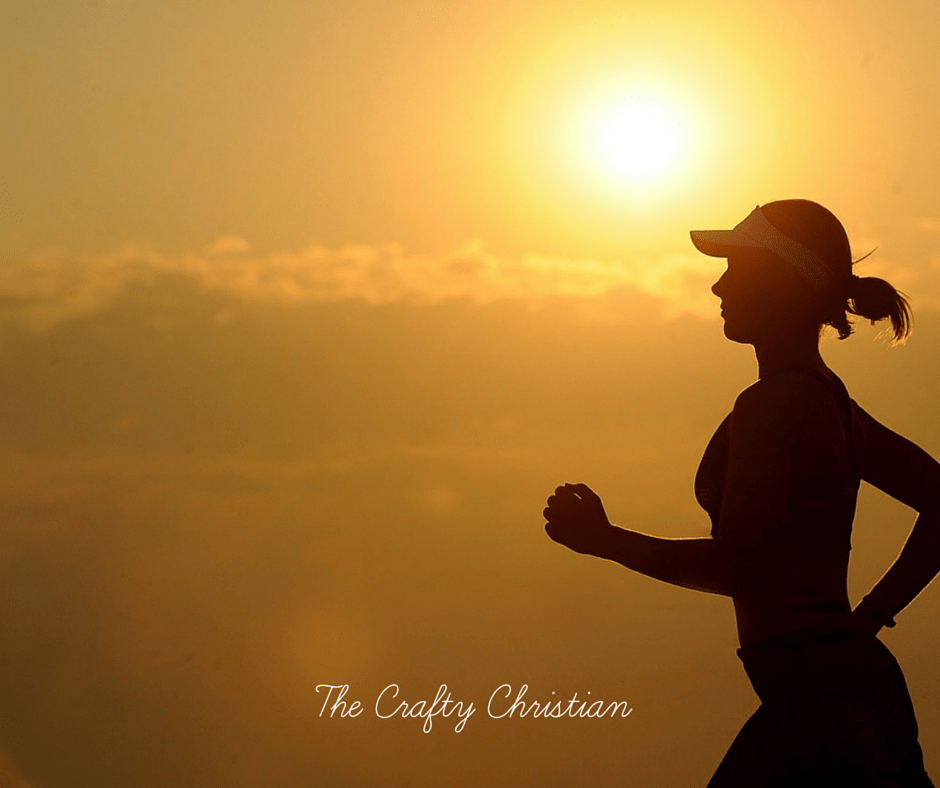 woman jogging with the sun setting behind her