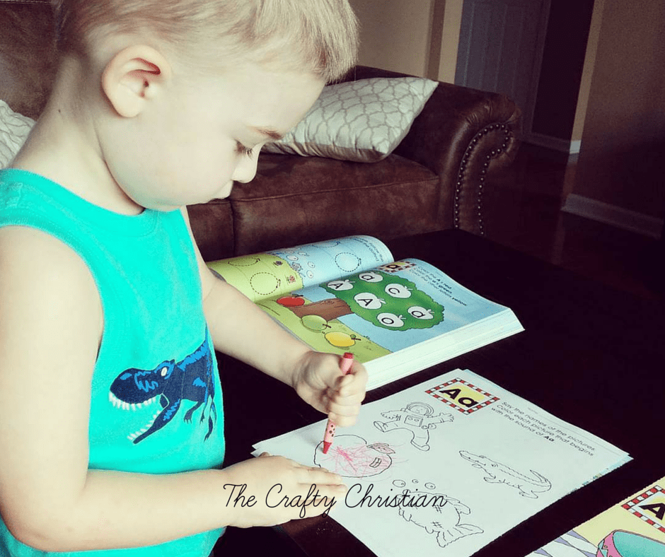 toddler working in a homeschool workbook