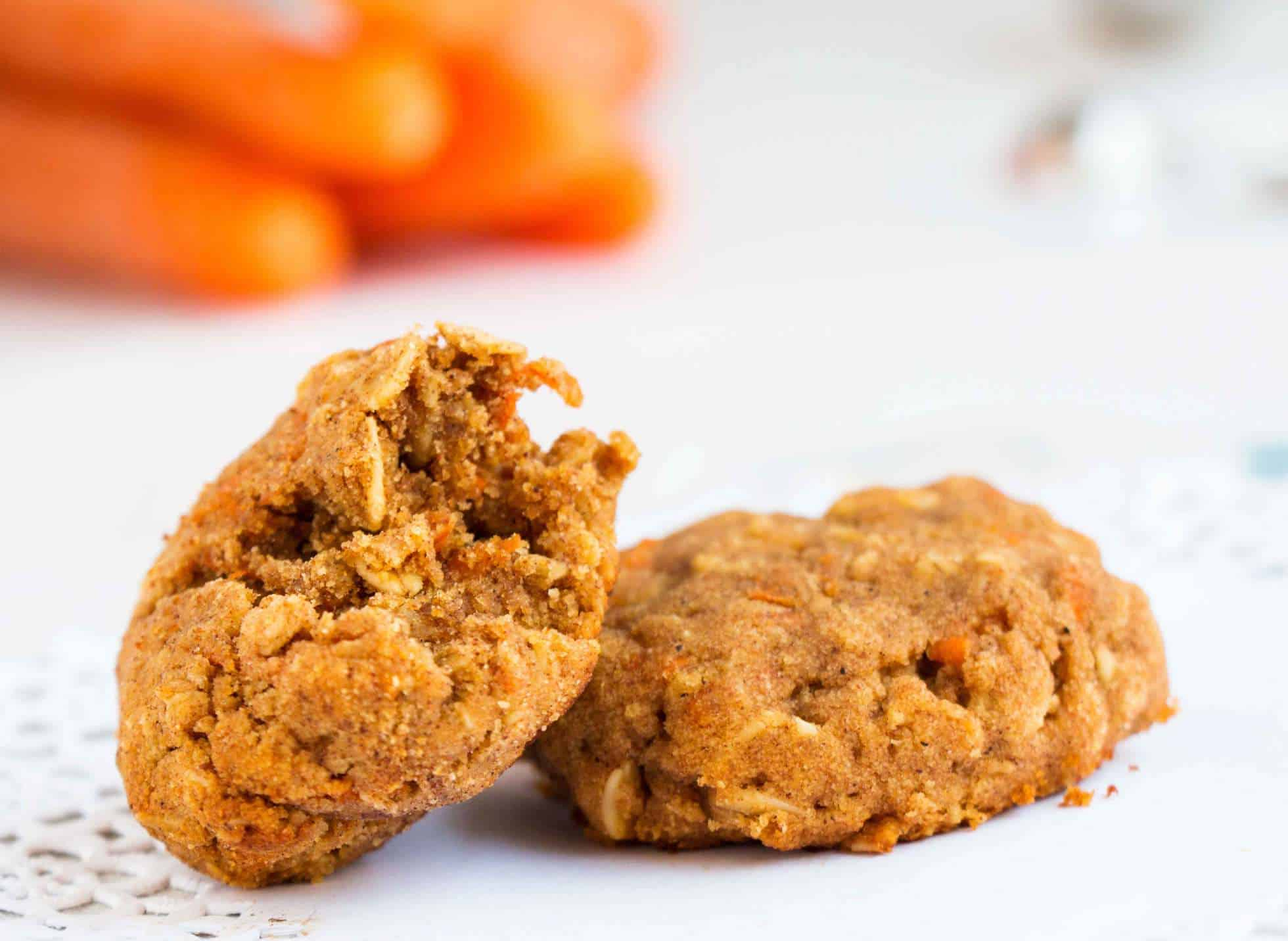 cinnamon carrot cookie with a bite out of it laying on another cookie
