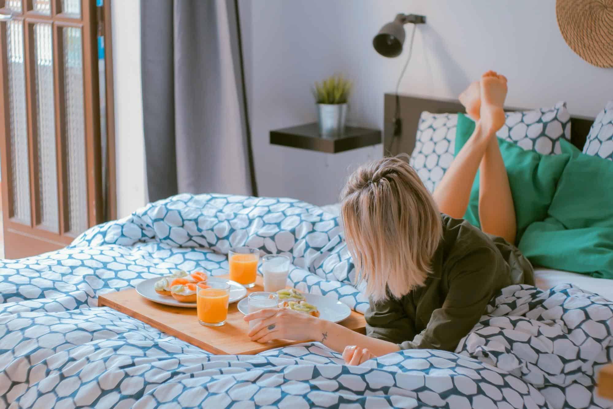 women eating breakfast in bed