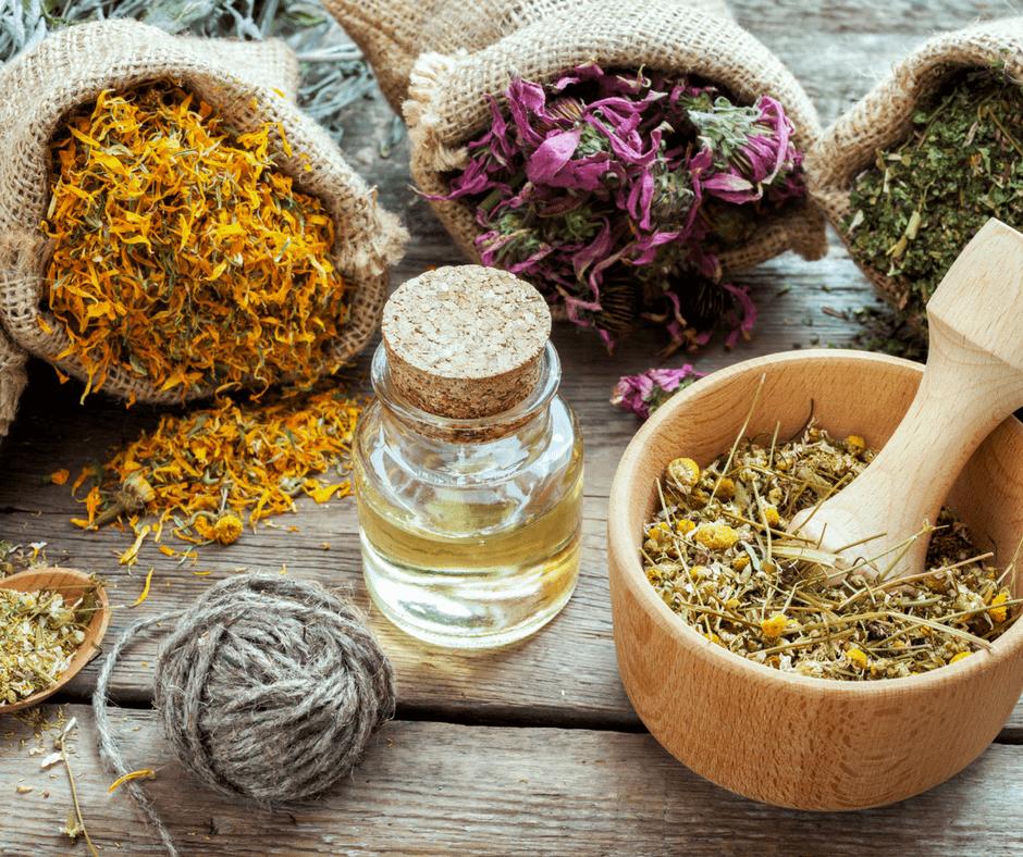 various herbs in burlap sacks