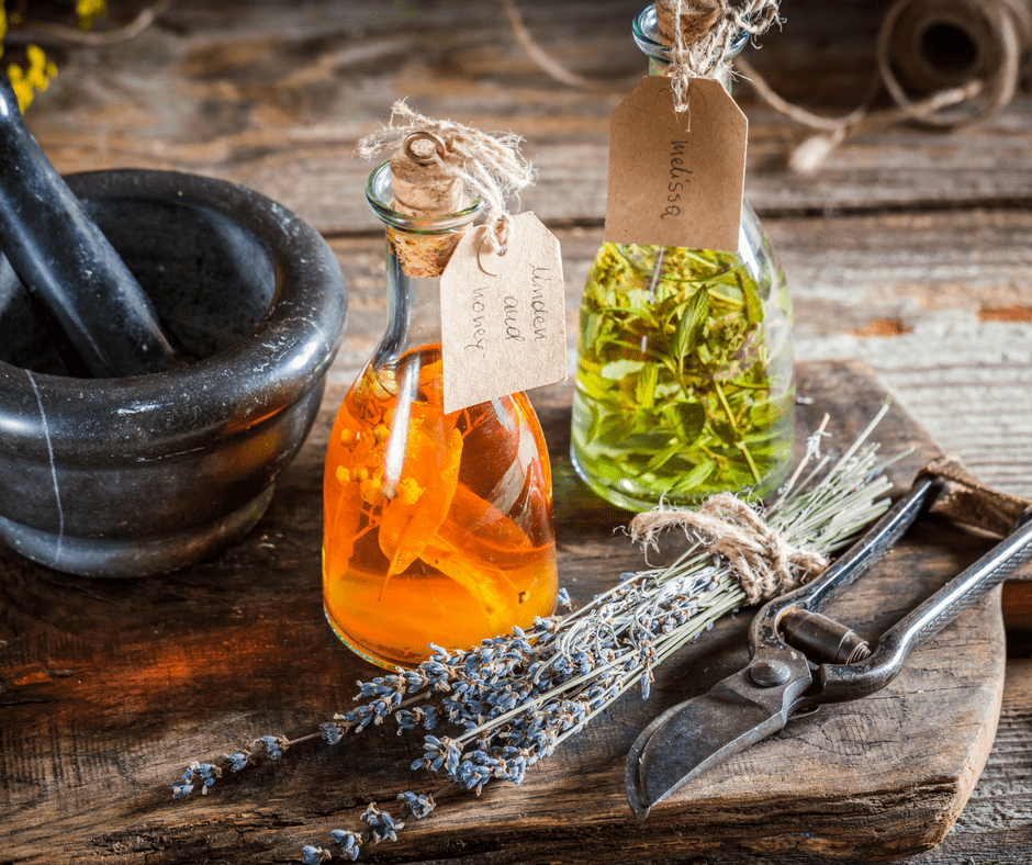 homemade tinctures on a wooden table