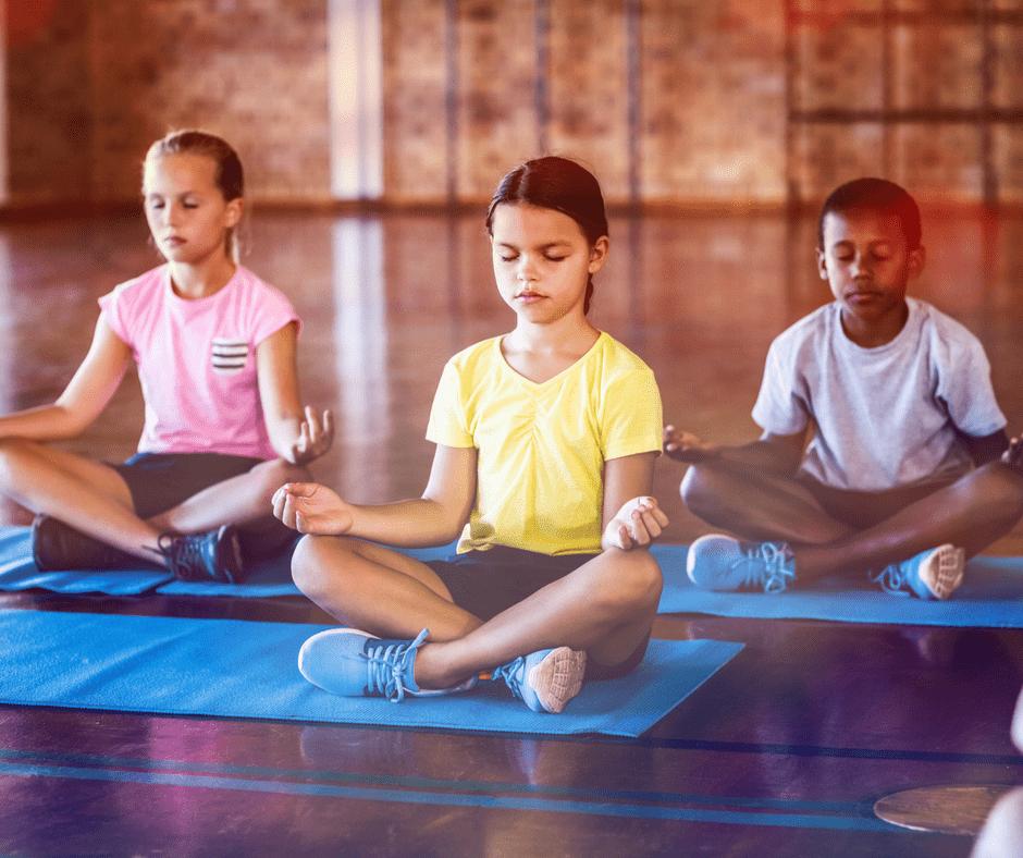 kids meditating on yoga mats