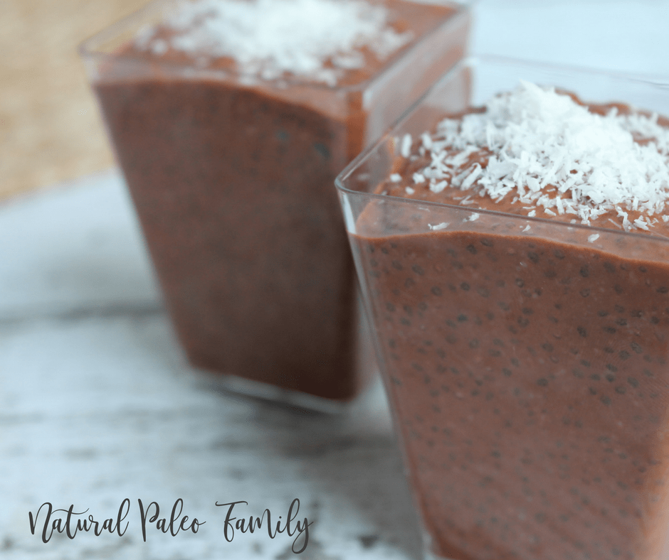 chocolate chia seed pudding in clear cups with coconut flakes on top