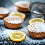 paleo lemon poppyseed muffins with sugar and lemons