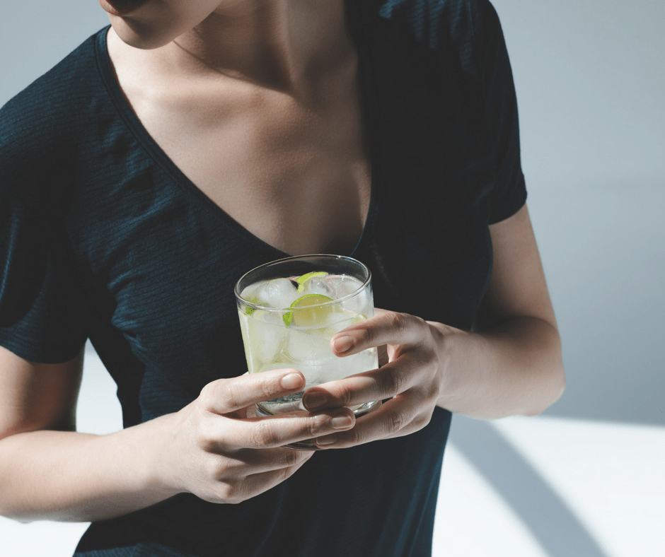 woman holding a gin and tonic