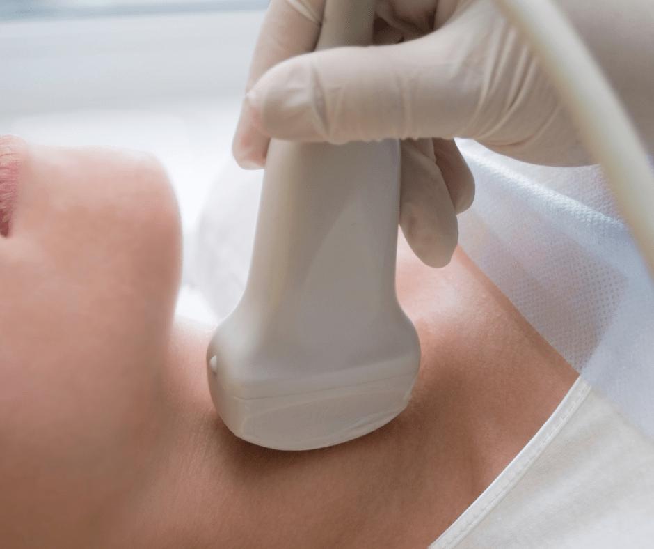 ultrasound wand on woman's neck